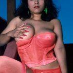 taking one boob out of tight red corset in tamil nadu