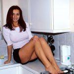 sexy housewife in kolkata sitting inkitchen