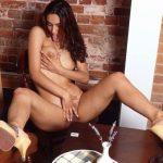 SITTING ON TABLE TOUCHING BREASTS