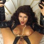 hot leather wearing girl holding both feet behind her head with a big dildo deep inside her tight pussy
